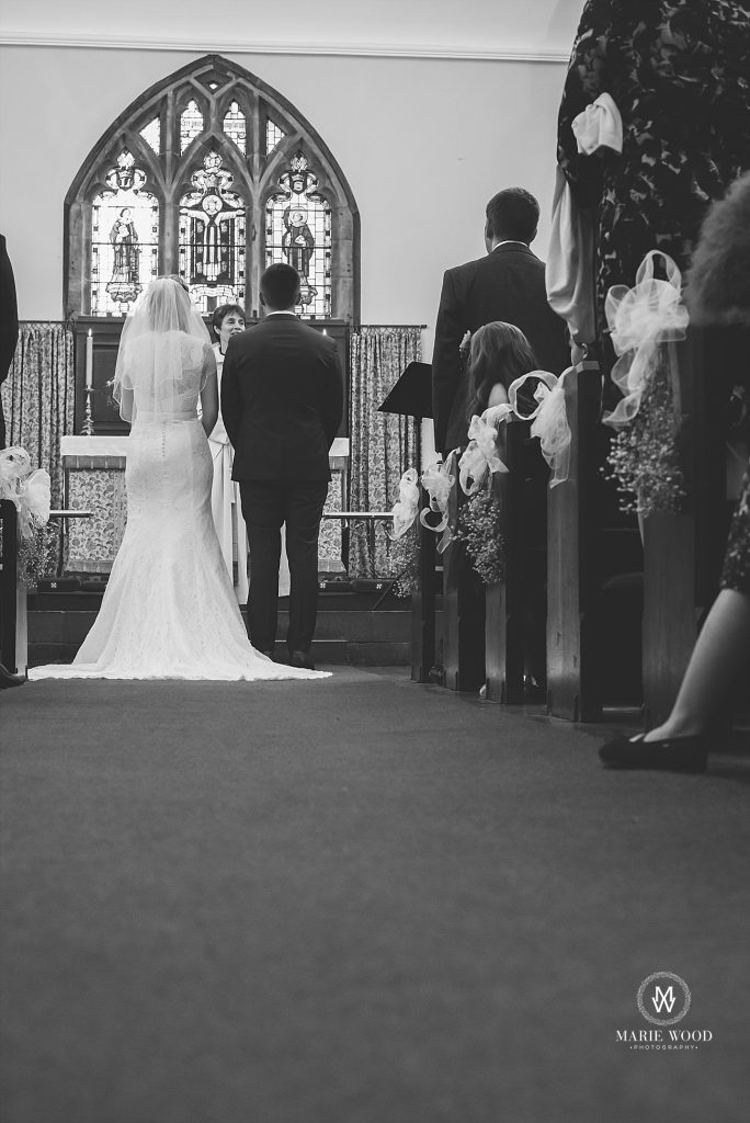 bride and groom stood at church altar