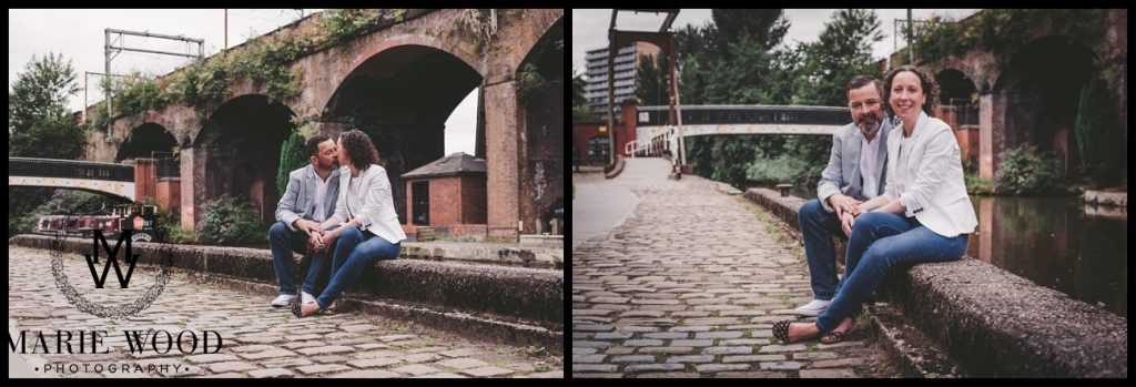 couple sat on the wall at castlefield manchester on their pre wedding shoot