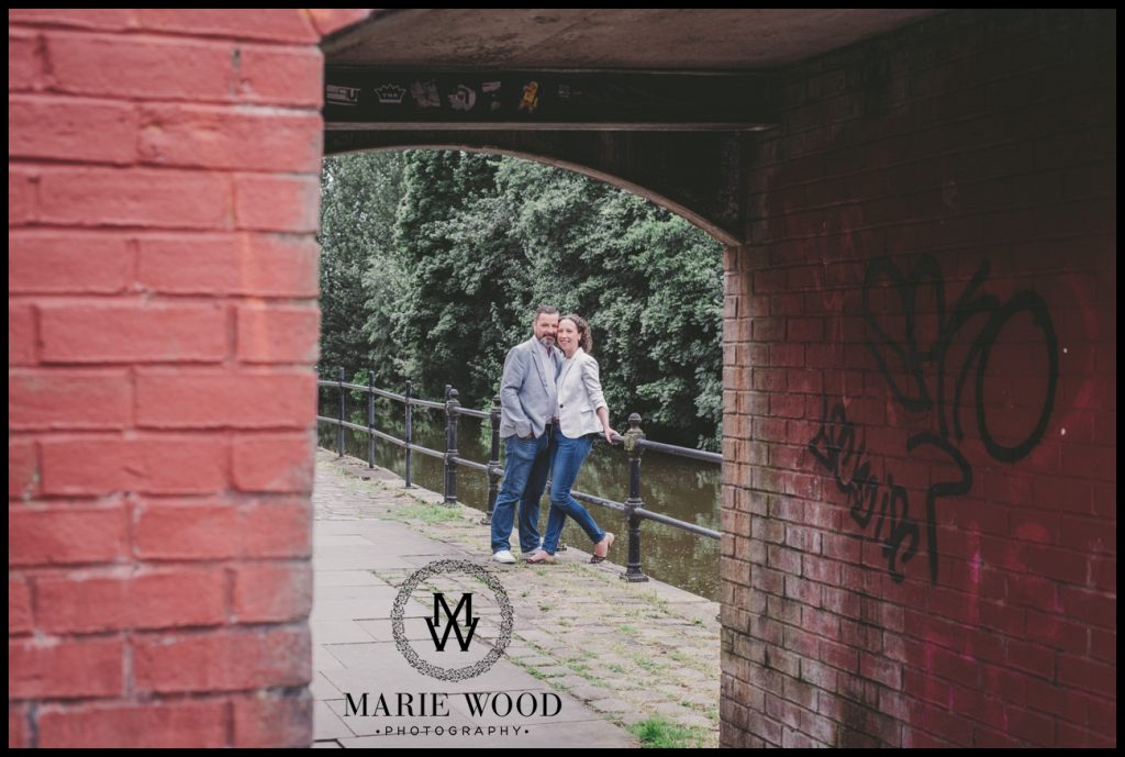 couple at the canal in castlefield manchester having an engagement shoot