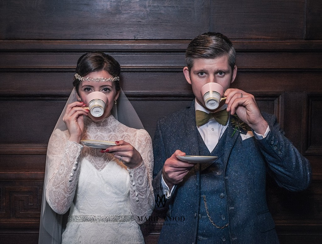 bride and groom drinking out of vintage tea cups in Eaves Hall in Clitheroe