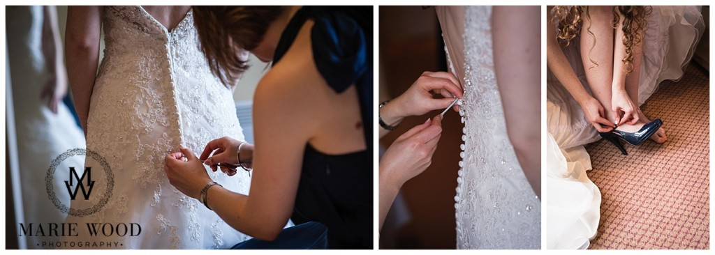 bride having her dress buttoned up by bridesmaid