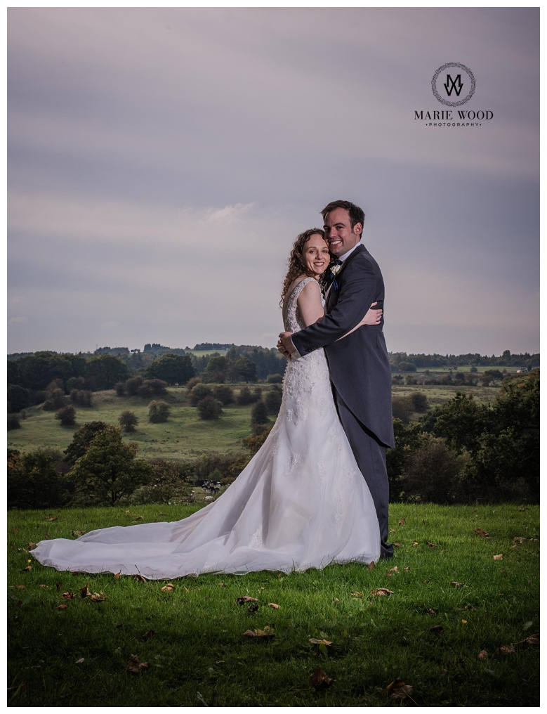 bride and groom hugging in the lanscaped garden of the dukenhalgh hotel