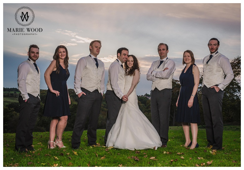 bride and groom with bridesmaids and ushers posing for a photograph