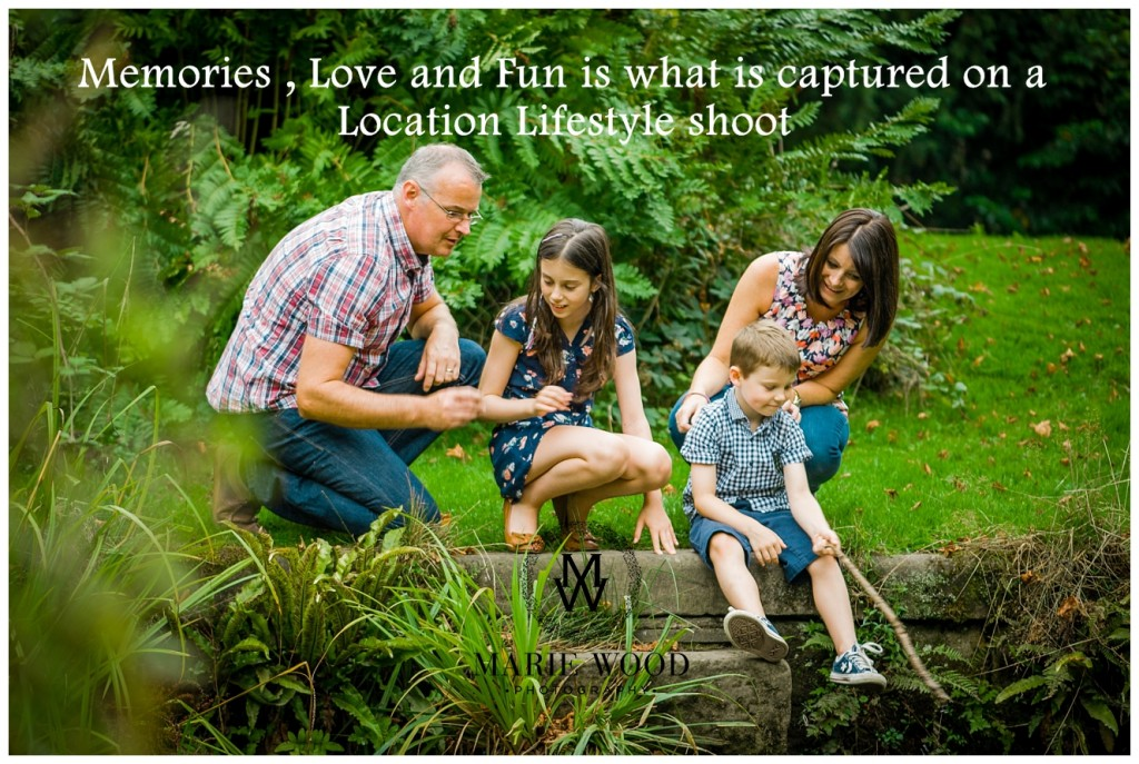 image of a family sat by a pond looking for frogs
