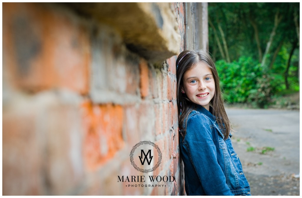 image of a girl stood against a wall in a whitefield park
