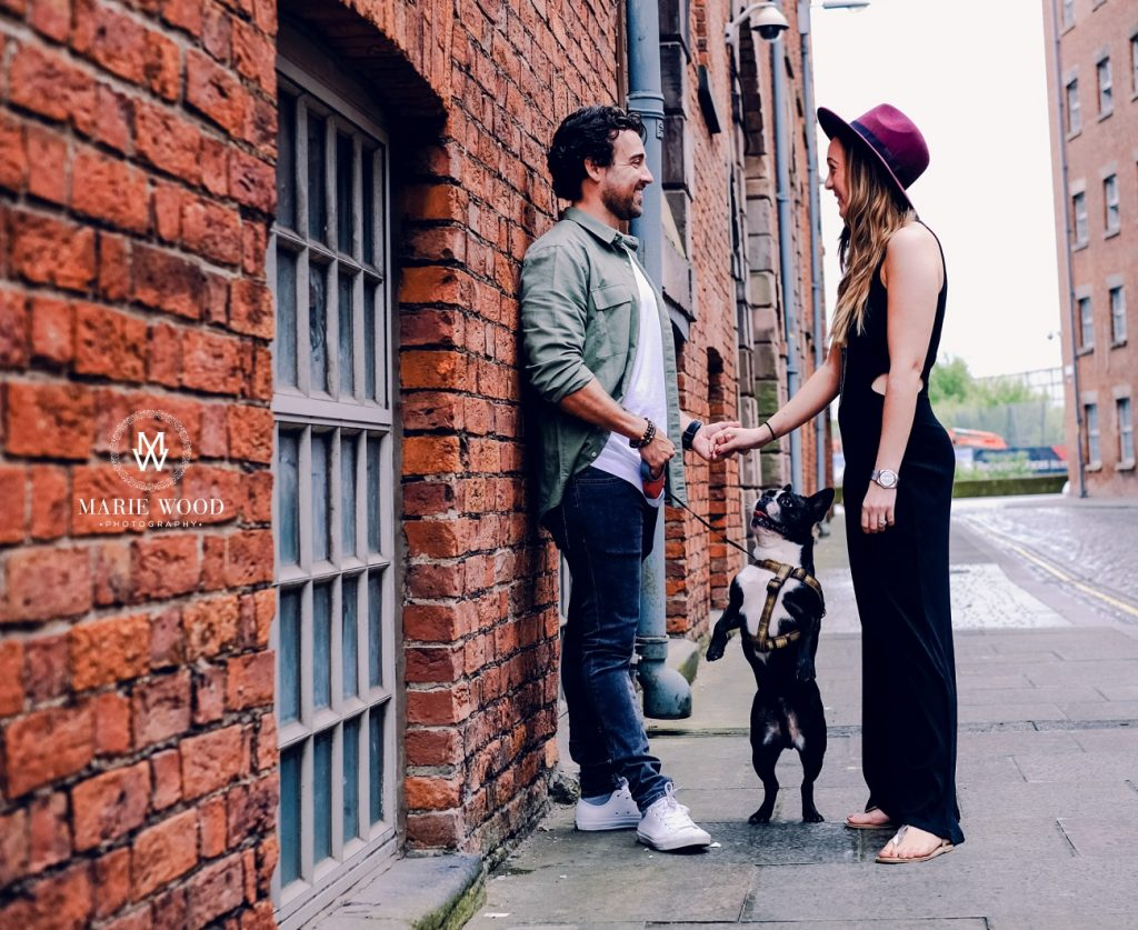 back street in ancoats with a couple and their dog