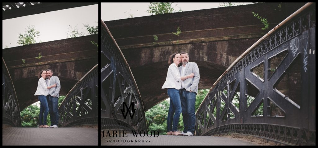 couple on a bridge in castlefield anchester having their pre wedding photoshoot