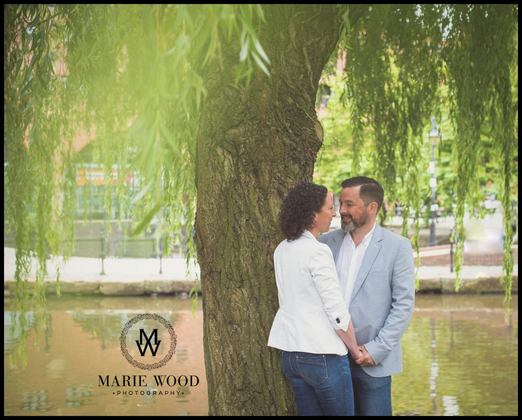 couple under the trees by the canal in manchester castlefield
